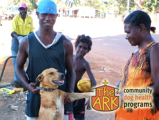 A recently treated dog in an indigenous community with his owners